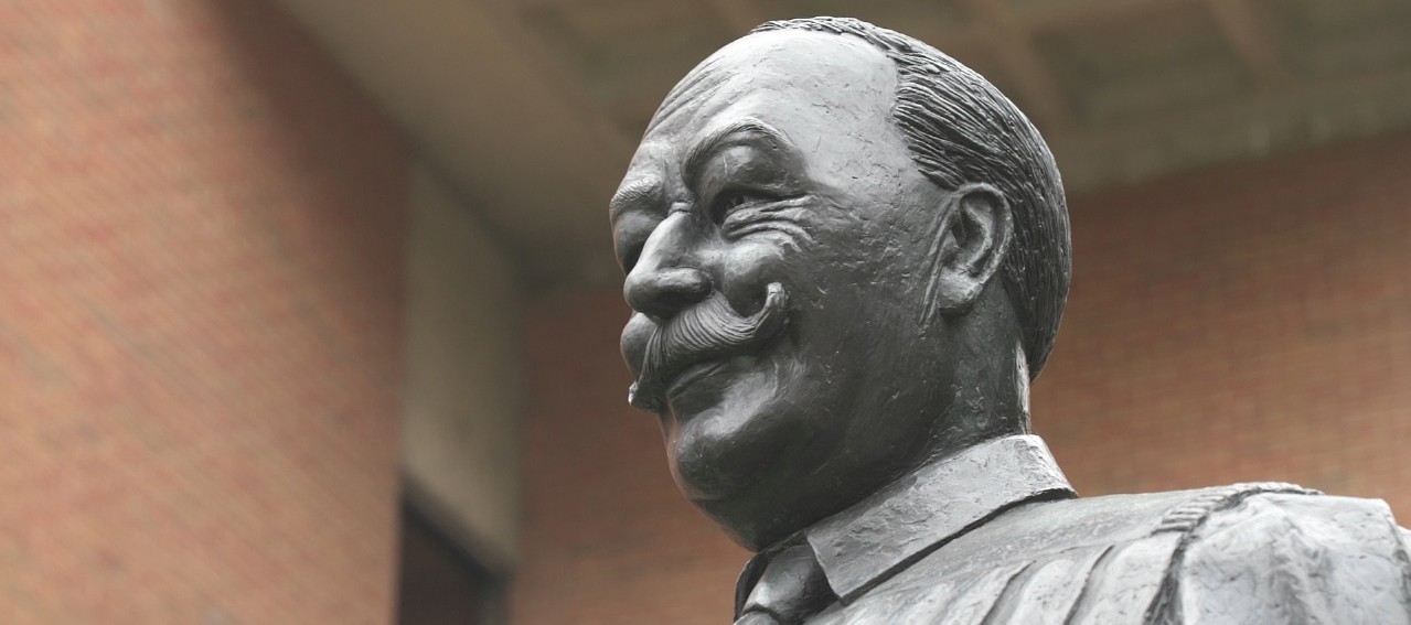 A statue of William Howard Taft near the rear entrance to the College of Law building.