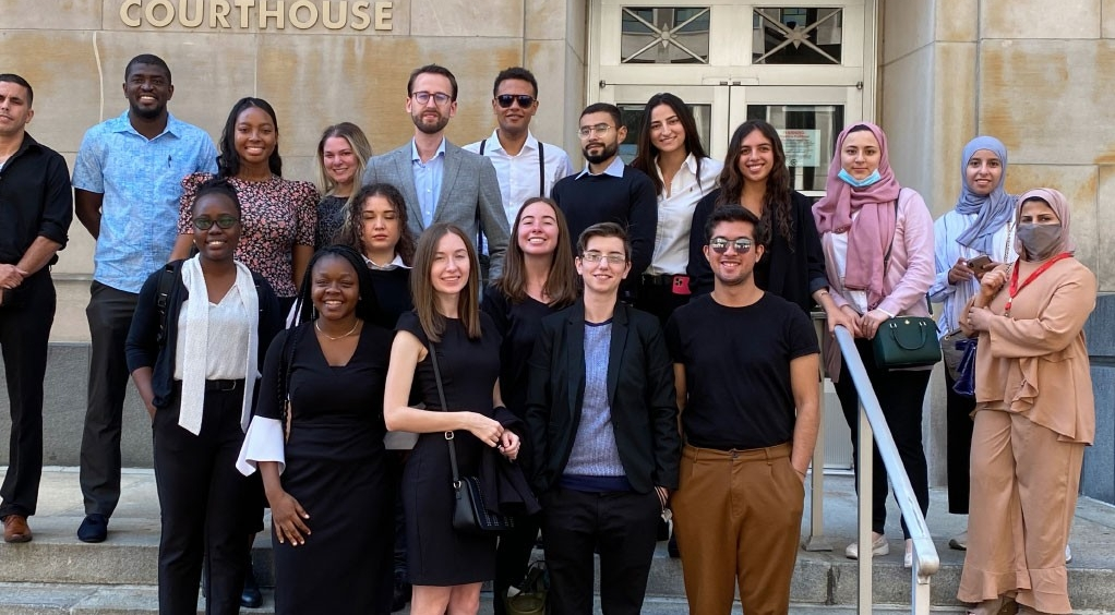 LLM class of 2018 standing together outside of the Law Library.