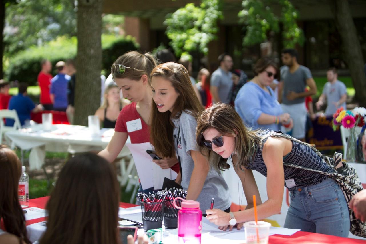 Students talking on Blegen Lawn outside of the law school.