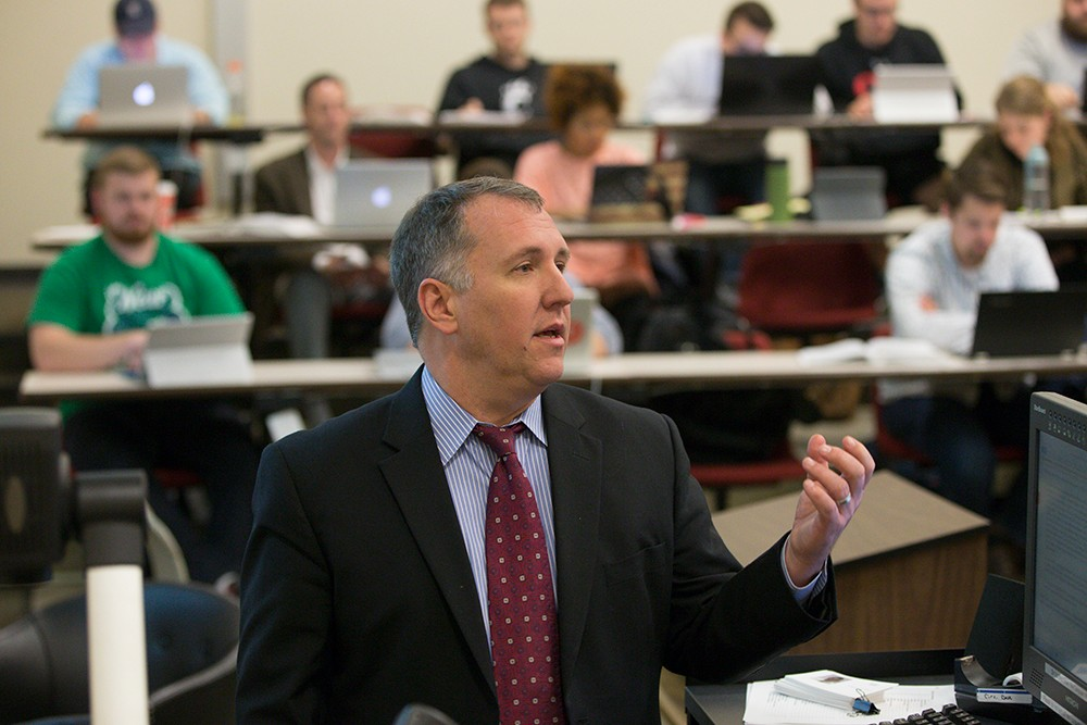 Professor and Director of the Ohio Innocence Project Mark Godsey teaching a class.